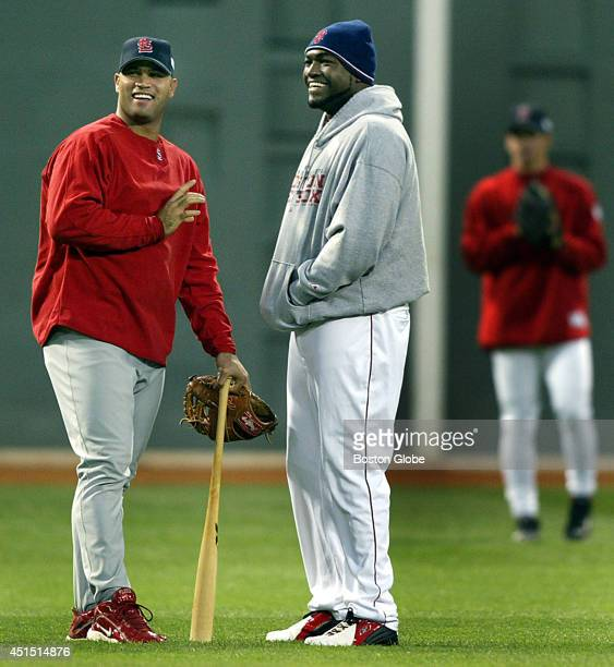 St Louis Cardinals first baseman Albert Pujols left and Boston Red Sox designated hitter David Ortiz get together for some yucks in the outfield...