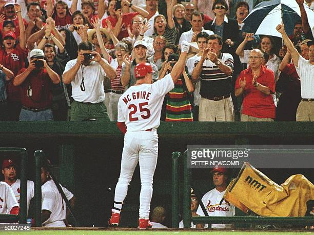 St Louis Cardinals first baseman Mark McGwire waves to the crowd at Busch Stadium in St Louis MO after hitting his 63rd home run while pinch hitting...