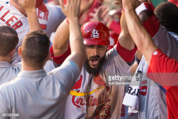 St Louis Cardinals first baseman Matt Carpenter celebrates in the dugout after hitting a grand slam home run during the MLB interleague game between...