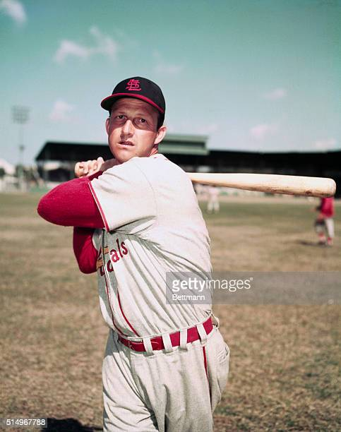 St Louis Cardinals first baseman Stan Musial poses with baseball bat   Location Brandenton Florida USA