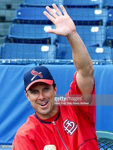 St Louis Cardinals' first baseman Tino Martinez waves greetings as his team takes to the field for batting practice before an exhibition game against...