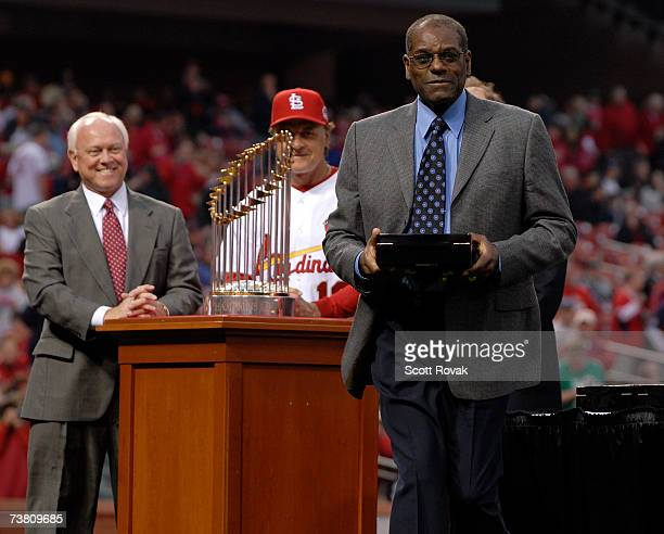 St Louis Cardinals Hall of Fame pitcher Bob Gibson receives his World Series ring from manager Tony LaRussa and Cardinals general manager Walt...