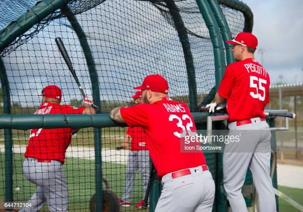 St Louis Cardinals Infielder Jhonny Peralta takes batting practice while St Louis Cardinals Infielder Matt Adams and St Louis Cardinals Outfielder...