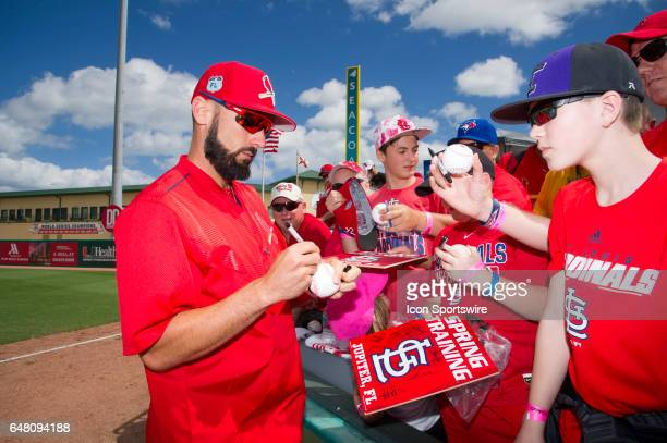 St Louis Cardinals Infielder Matt Carpenter signs autographs for fans during an MLB spring training game between the Washington Nationals and the St...