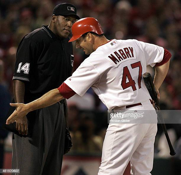 St Louis Cardinals John Mabry argues to no avail with home plate umpire Chuck Meriweather after a controversial out in the fifth inning