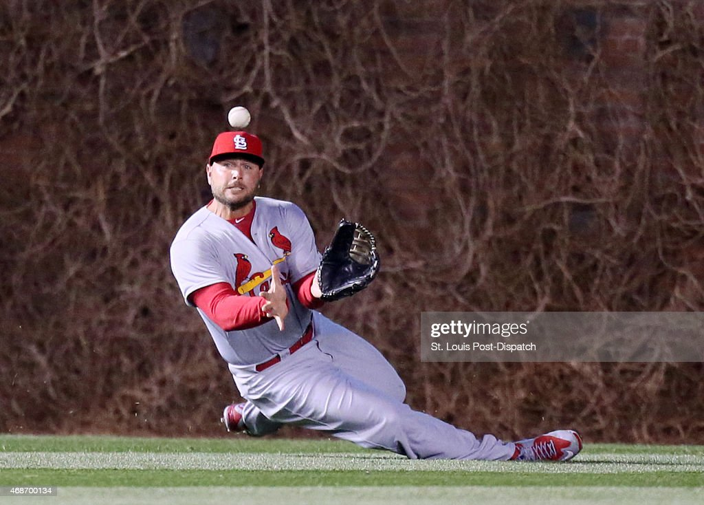 St. Louis Cardinals left fielder Matt Holliday catches a line drive off the bat of Chicago Cubs' Jorge Soler during the sixth inning on Sunday, April 5, 2015, at Wrigley Field in Chicago.