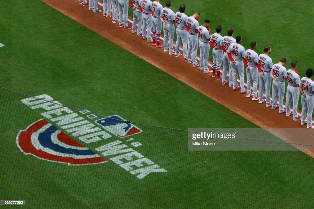 St. Louis Cardinals look on during the National Anthem prior to the start of the game against the New York Mets on Opening Day at Citi Field on March 29, 2018 in the Flushing neighborhood of the Queens borough of New York City.