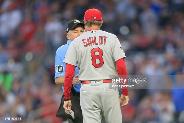 St Louis Cardinals manager Mike Shildt talks to the home plate umpire after his pitcher hit Ronald Acuna during the fifth and final game of the...