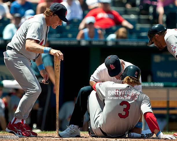 St Louis Cardinals manager Tony LaRussa left looks over the Cardinals' Khalil Greene after he was hit in the foot by a pitch from Kansas City Royals...