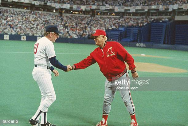 St Louis Cardinals' manager Whitey Herzog and Minnesota Twins' manager Tom Kelly meet for the customary pregame handshake during the World Series at...
