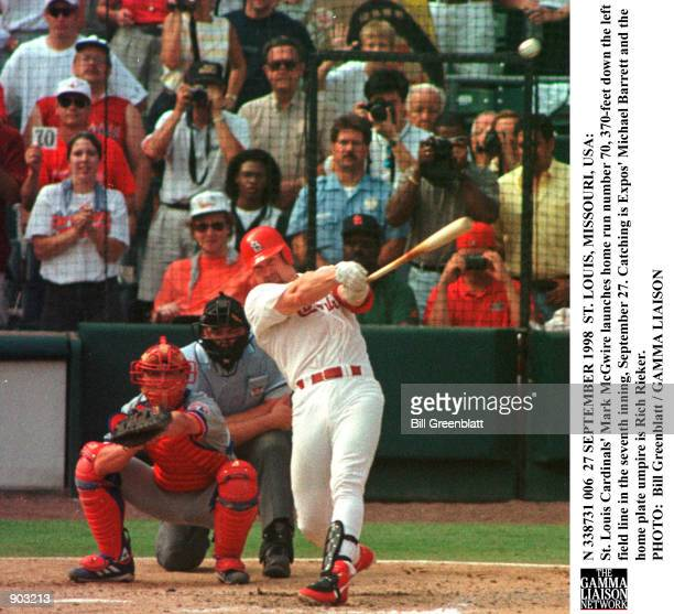 St Louis Cardinals'' Mark McGwire launches home run number 70 370feet down the left field line in the seventh inning September 27 Catching is Expos''...