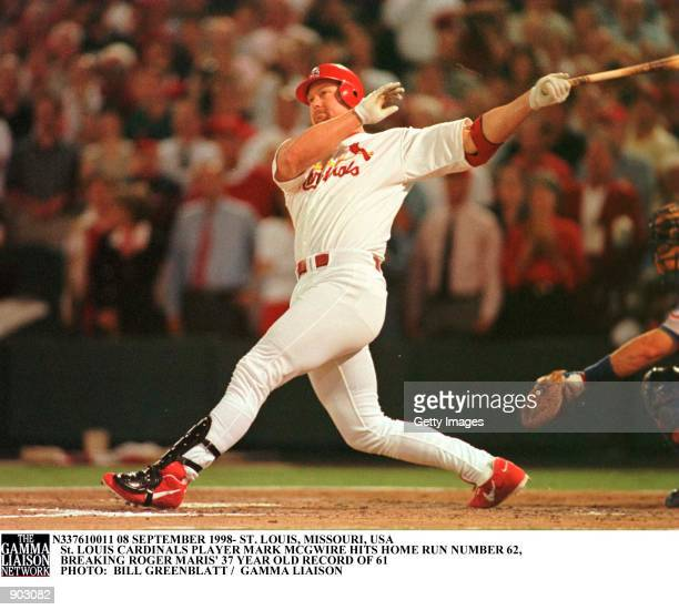 St. Louis Cardinals'' Mark McGwire takes a big swing as he watches history being made, with his 341-foot-62nd home run of the season in the fourth...