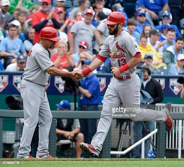 St Louis Cardinals' Matt Carpenter is congratulated by third base coach Jose Oquendo after hitting a tworun home run during the sixth inning on...