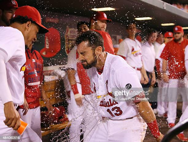 St Louis Cardinals' Matt Carpenter is splashed with water by pitcher Carlos Martinez after hitting a solo home run in eighth inning action during a...