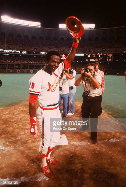 St Louis Cardinals' outfielder Lou Brock tips his hat to the crowd after singling off Chicago's Dennis Lamp for his 3000th major league hit during a...