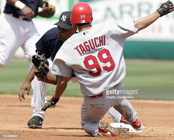 St. Louis Cardinals outfielder So Taguchi steals second base successfully beating the tag from New York Yankees 2nd baseman Robinson Cano in a spring...