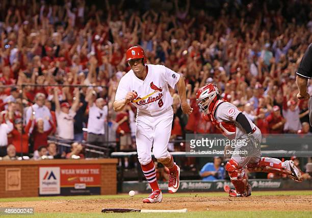 St Louis Cardinals pinch runner Peter Bourjos returns to the dugout after scoring the goahead run on a double by Stephen Piscotty during eighth...