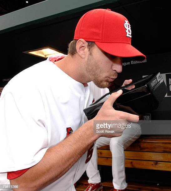 St Louis Cardinals pitcher Adam Wainwright kisses the box after receiving his World Series ring during a Ceremony before the game against the New...