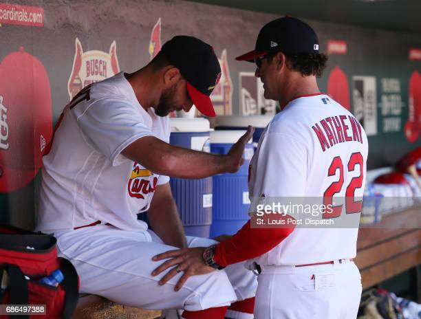 St Louis Cardinals pitcher Adam Wainwright talks with manager Mike Matheny in the dugout after Wainwright was relieved in the seventh inning during a...