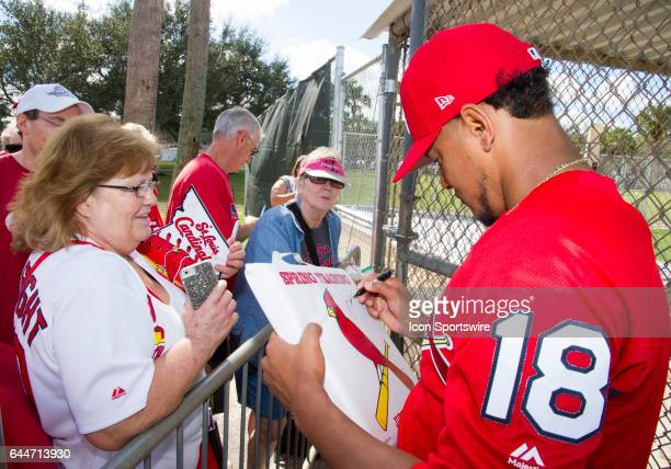 St Louis Cardinals Pitcher Carlos Martinez signs autographs for fans during a St Louis Cardinals spring training workout at Roger Dean Stadium in...