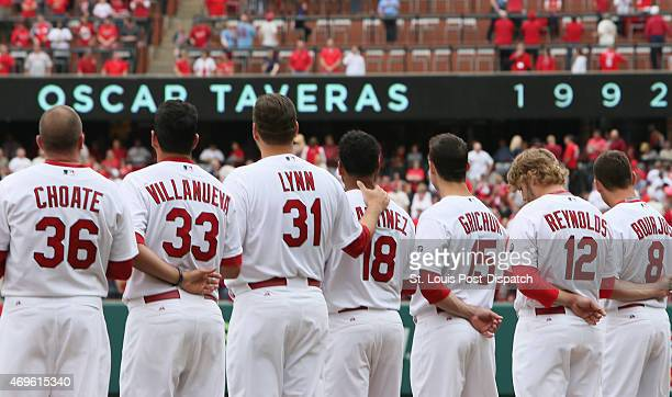St Louis Cardinals pitcher Lance Lynn puts his arm around pitcher Carlos Martinez after a video tribute was played in honor of former outfielder...