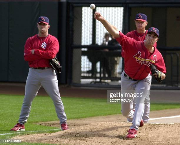 St Louis Cardinals' pitcher Matt Morris works out in the bullpen beside coach Dave Duncan and Jim Edmonds during the workout day of the NLCS in San...