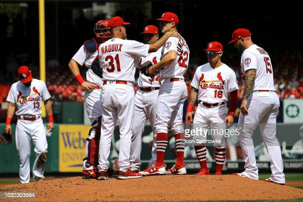 St Louis Cardinals pitching coach Mike Maddux talks to St Louis Cardinals starting pitcher Daniel Poncedeleon during the game between the St Louis...