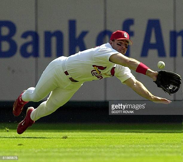 St Louis Cardinals player Jim Edmonds makes a diving attempt on a ball hit by the Atlanta Braves' Rafael Furcal in the first inning of game one of...