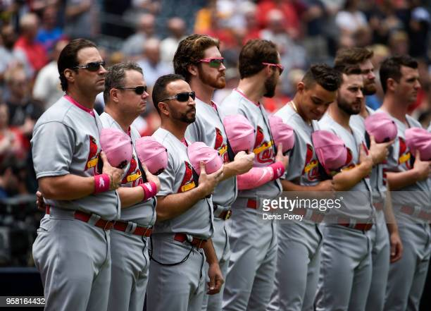 St Louis Cardinals players and coaches lineup for the national anthem before a baseball game against the San Diego Padres at PETCO Park on May 13...