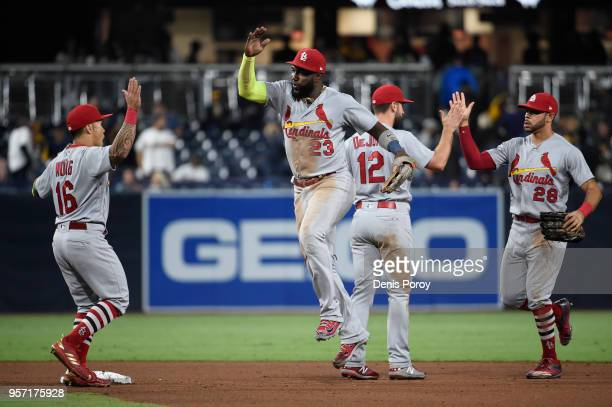 St Louis Cardinals players celebrate after beating the San Diego Padres 21 in a baseball game at PETCO Park on May 10 2018 in San Diego California