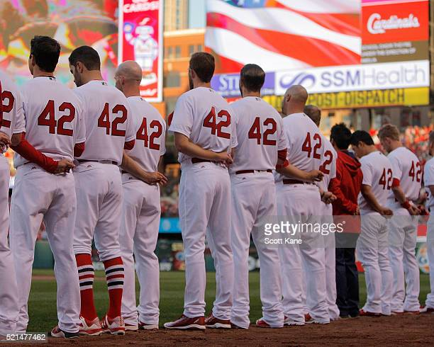 St Louis Cardinals players stand for the Nation Anthem prior to baseball game against the Cincinnati Reds at Busch Stadium on April 15 2016 in St...