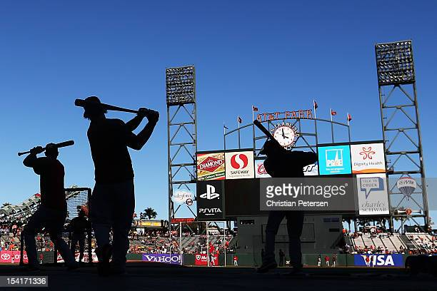 St. Louis Cardinals players warm up during batting practice prior to Game Two of the National League Championship Series against the San Francisco...