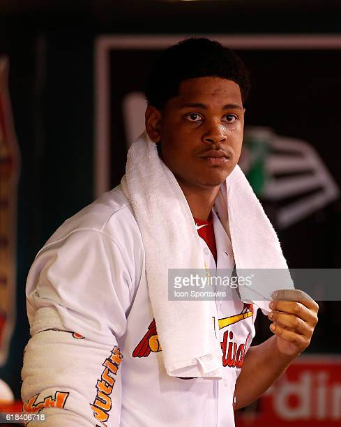 St Louis Cardinals relief pitcher Alex Reyes stands in the dugout during the fifth inning of a baseball game against the New York Mets at Busch...