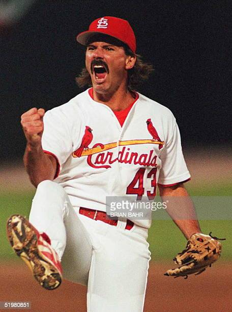 St Louis Cardinals relief pitcher Dennis Eckersley celebrates his team's 43 victory over the Atlanta Braves 13 October in game four of the National...