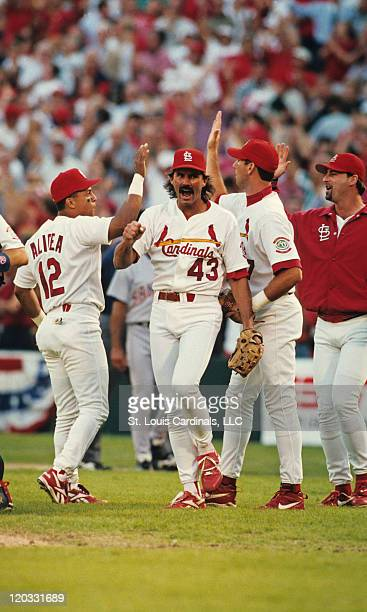 St Louis Cardinals relief pitcher Dennis Eckersley celebrates with teammates Luis Alicea and John Mabry following Game 1 of the 1996 NLDS versus the...