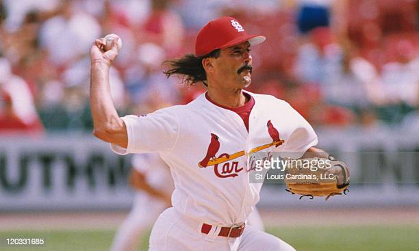 St Louis Cardinals relief pitcher Dennis Eckersley delivers a pitch during a game circa 1997 at Busch Stadium in St Louis Missouri