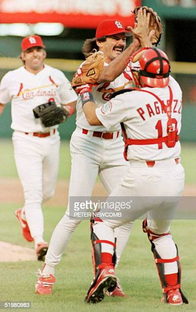 St Louis Cardinals relief pitcher Dennis Eckersley hugs catcher Tom Pagnozzi as teammate Gary Gaetti runs in after the final out against San Diego...