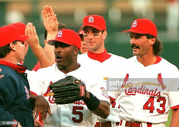 St Louis Cardinals Ron Gant John Mabry and Dennis Eckersley celebrate their 32 victory over the Atlanta Braves 12 October in game three of the...