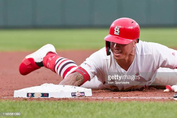 St. Louis Cardinals Second base Kolten Wong dives into third with a triple during game two of today's double header featuring the Cincinnati Reds at...