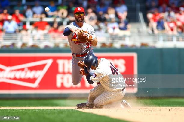 St Louis Cardinals second baseman Greg Garcia throws to 1st on a double play during the regular season game between the St Louis Cardinals and the...