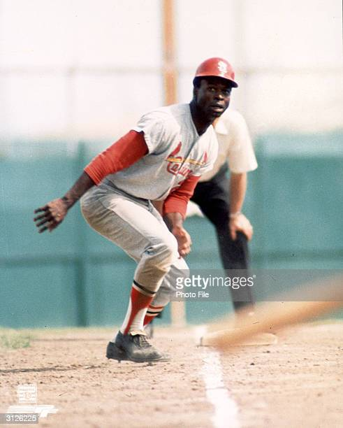 St Louis Cardinals second baseman Lou Brock leads off third plate during a game 1960s