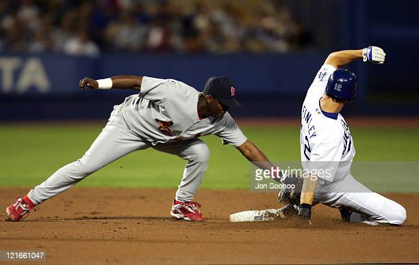 St Louis Cardinals shortstop Edgar Renteria tags out Los Angeles Dodgers runner Steve Finley in the first inning Friday September 10 2004 The Dodgers...