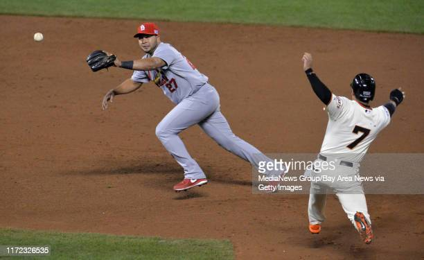 St. Louis Cardinals shortstop Jhonny Peralta has to come off the bag at second base as he fields an errant relay from first baseman Matt Adams in the...