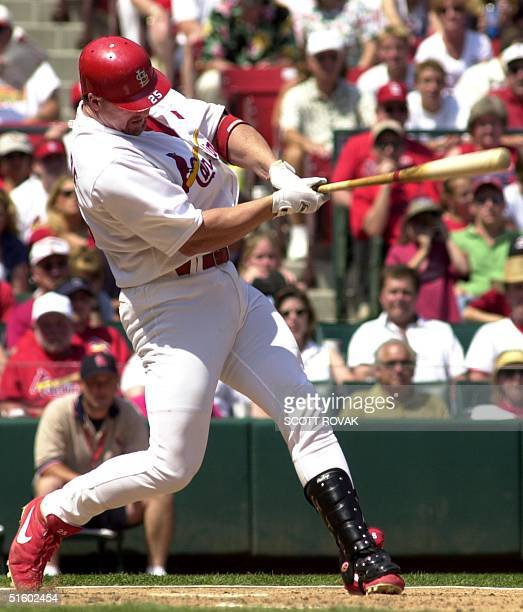 St Louis Cardinals' slugger Mark McGwire connects for a solo home run in the sixth inning against the Milwaukee Brewers 28 May 2001 It was McGwire's...