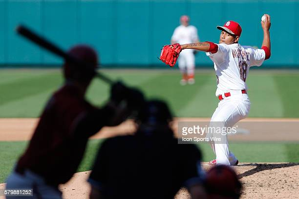 St. Louis Cardinals starting pitcher Carlos Martinez delivers a pitch during the game between the Arizona Diamondbacks and St. Louis Cardinals at...