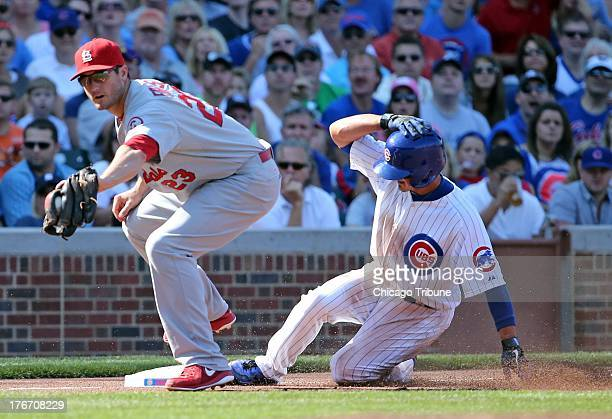 St Louis Cardinals third baseman David Freese forces out the Chicago Cubs' Darwin Barney in the third inning on Saturday August 17 at Wrigley Field...