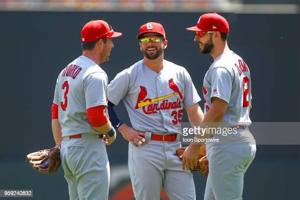 St Louis Cardinals third baseman Jedd Gyorko second baseman Greg Garcia and St Louis Cardinals shortstop Paul DeJong talk during a mound visit during...