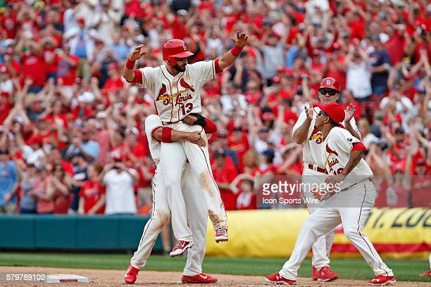 St Louis Cardinals third baseman Matt Carpenter is congratulated by teammates after hitting the winning hit in the bottom of the 11th during the game...