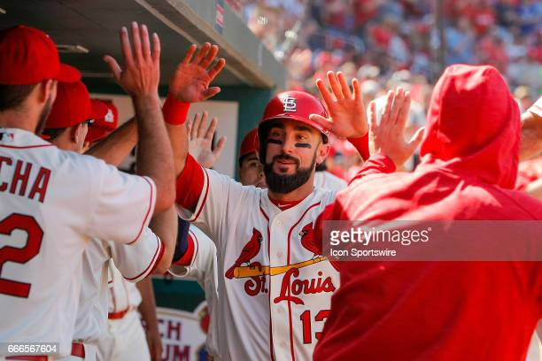 St Louis Cardinals third baseman Matt Carpenter is congratulated by teammates after scoring a run during the sixth inning of a baseball game against...