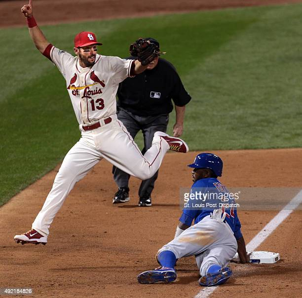 St Louis Cardinals third baseman Matt Carpenter prematurely celebrates picking off Chicago Cubs runner Dexter Fowler on a double play attempt in the...